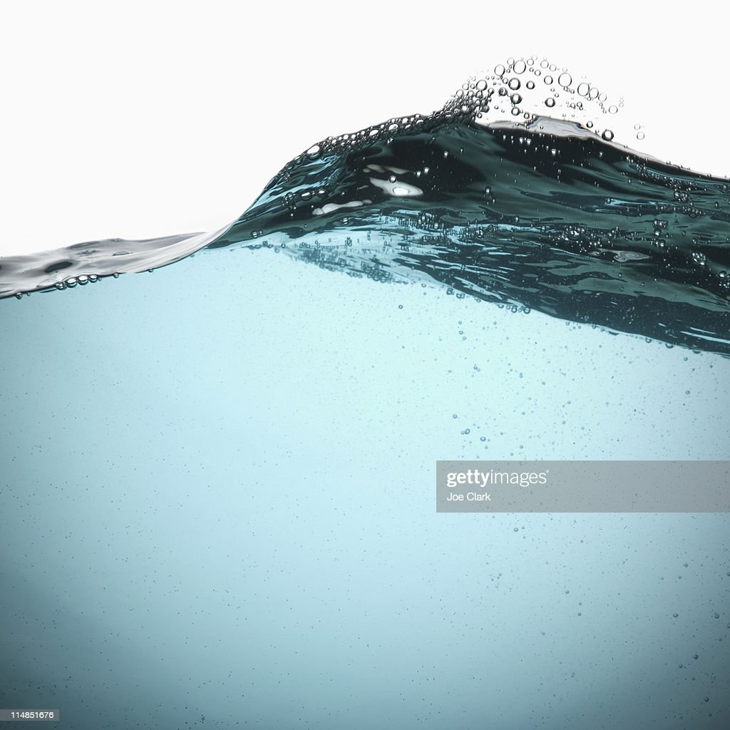 Water with bubbles on white background