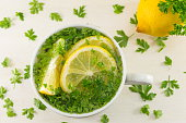 Water with parsley and lemon. Diet beverage