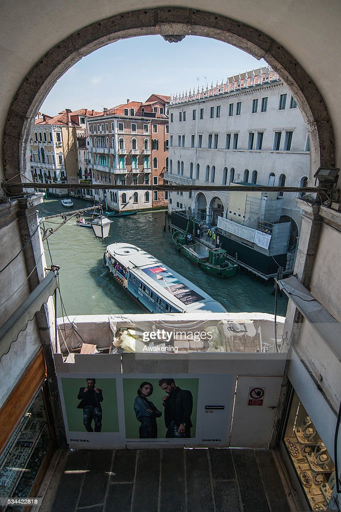 A waterbus passes on the Grand Canal during the renovation of the Rialto Bridge on May 26, 2016 in Venice, Italy. Site visits were organized to see the renovation of the Rialto bridge to coincide with the 15th Biennale of Architecture in Venice.