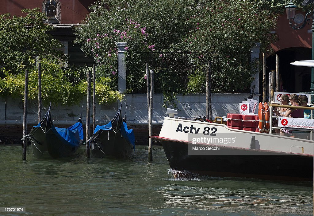 A waterbus sails in front of two Gondolas near the same pontoon where few hours earlier a German tourist was crashed to death on August 17, 2013 in Venice, Italy. A German tourist was crushed to death on Saturday when the gondola he was boarding collided with a waterbus (Vaporetto) along Venice's Grand Canal.