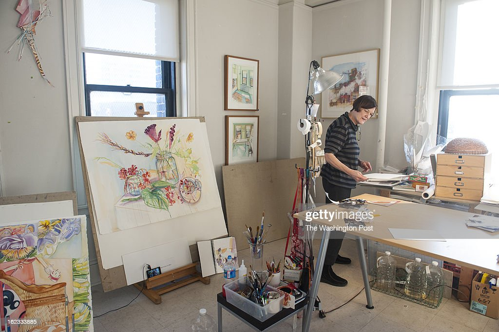 Watercolor artist Martha Dougherty rents one of the 30 artists studios in the Bromo Seltzer tower where she straightens up Wednesday February 14, 2013 in Baltimore, MD.