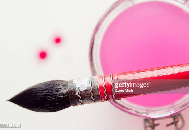 Watercolor brush being up to preserving jar