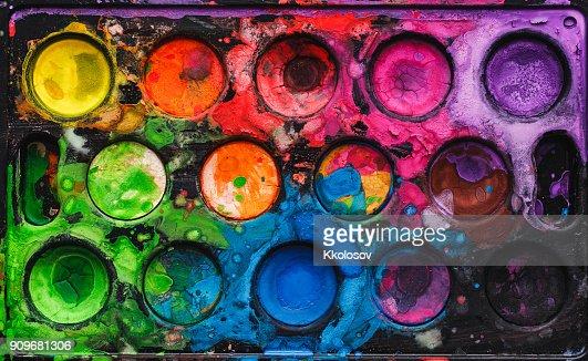 Watercolor palette with mixed colors : Foto de stock