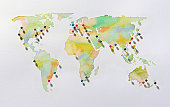 Watercolour world map with pins in it