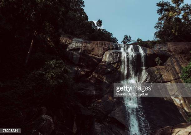 Waterfall Against Sky At Forest