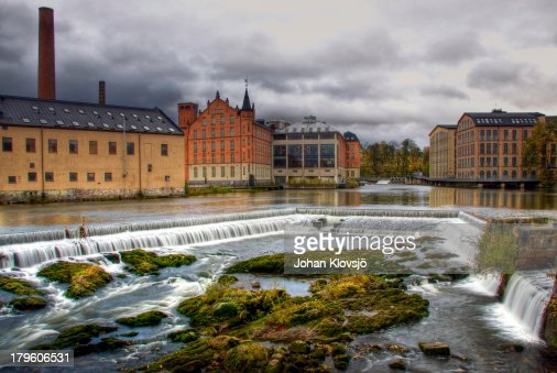Waterfall and houses in Norrköping's industry area