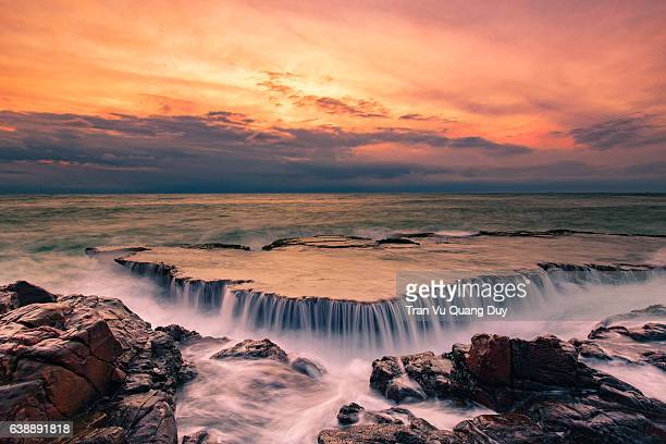waterfall below dawn.
