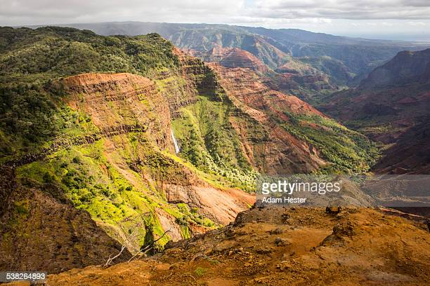 A waterfall inside of Waimea Canyon on a island