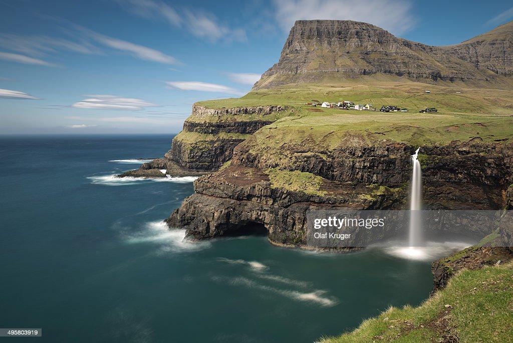 Waterfall on the cliffs near a village, Gasadalur, Vagar, Faroe Islands, Denmark