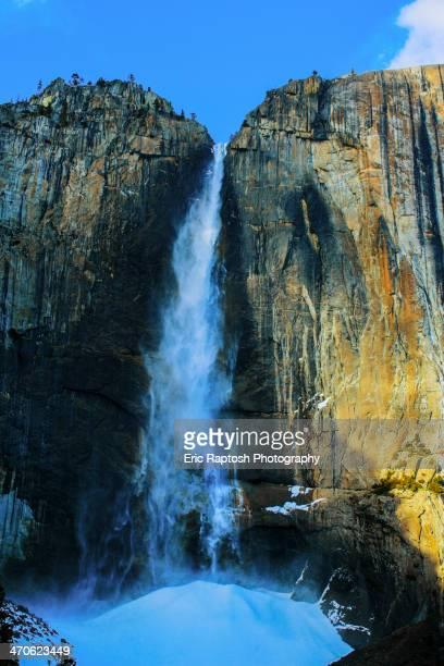 Waterfall over sheer rocky cliffs, Yosemite, California, United States