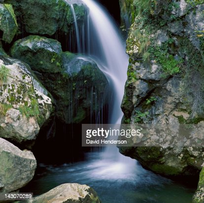 Waterfall pouring over rock formations