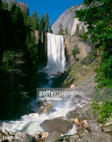 Waterfall pouring over rocky cliff : Stock Photo