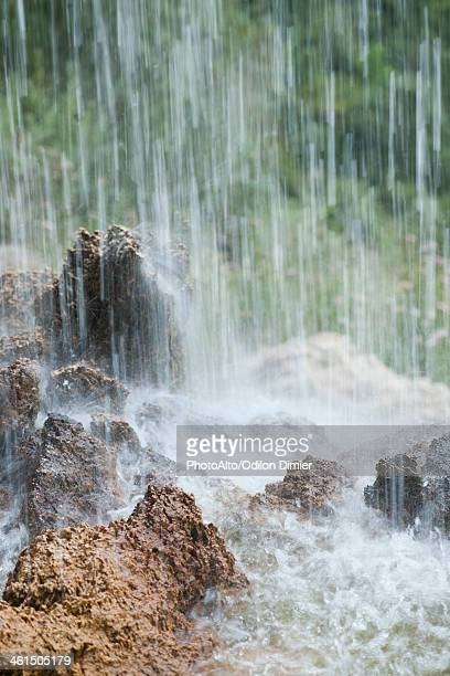 Waterfall splashing on rocks