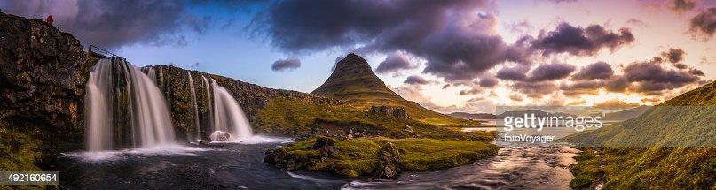 Waterfall sunrise idyllic mountain stream through panoramic peaks Kirkjufell Iceland