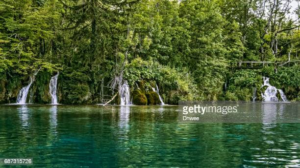 Waterfalls With Its Emerald Lake In Plitvice National Park, Croatia