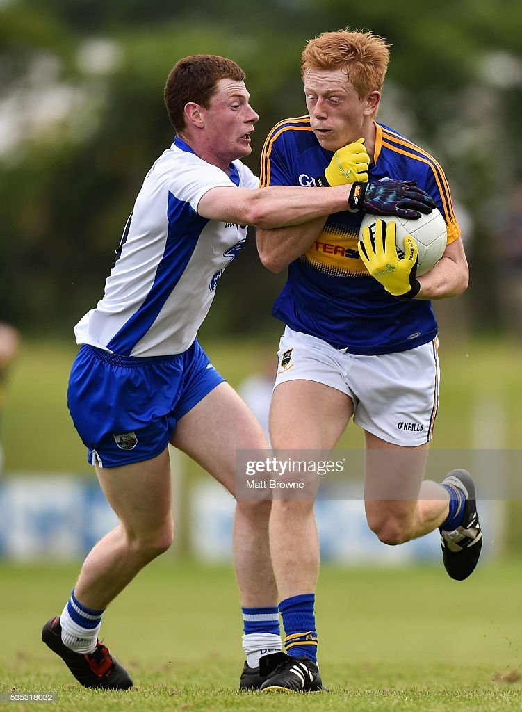 Waterford , Ireland - 29 May 2016; Josh Keane of Tipperary in action against Michael Curry of Waterford in the Munster GAA Football Senior Championship quarter-final between Waterford and Tipperary at Fraher Field, Dungarvan, Co. Waterford.