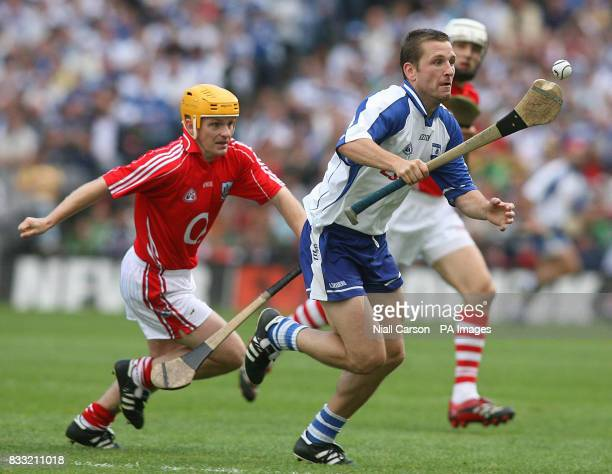 Waterford's Ken McGrath is chased by Joe Dean of Cork during the Guinness All Ireland Hurling Championship Quarter Final match at Croke Park Dublin