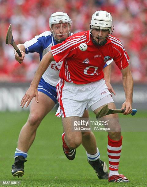 Waterford's Stephen Molumphy chases Patrick Cronin of Cork during the Guinness All Ireland Hurling Championship Quarter Final match at Croke Park...