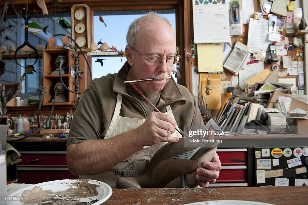 Waterfowl decoy carver demonstrating his craft. : Stock Photo