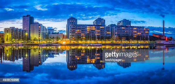 Waterfront apartment buildings panorama warmly illuminated at dusk Helsinki Finland