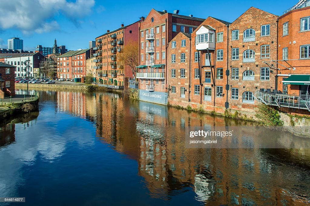 Waterfront buildings along Aire river, Leeds, England, UK : Stock Photo