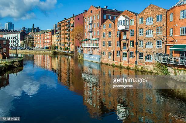 Waterfront buildings along Aire river, Leeds, England, UK