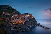 Waterfront cliff town of Manorola by nightfall, Cinque Terre, Italy