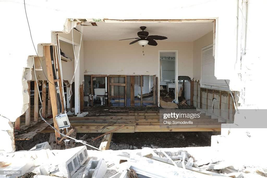 A waterfront home is left with a giant hole after being destroyed by Hurricane Irma on September 12, 2017 in Marathon, Florida. The Federal Emergency Managment Agency has reported that 25-percent of all homes in the Florida Keys were destroyed and 65-percent sustained major damage when they took a direct hit from Hurricane Irma.