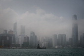 A waterfront of the Victoria Harbour where the People's Liberation Army barracks are located is seen in Hong Kong on February 17 2014 Plans to...