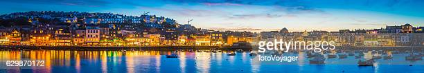 Waterfront restaurants homes warmly illuminated picturesque harbour St Ives Cornwall