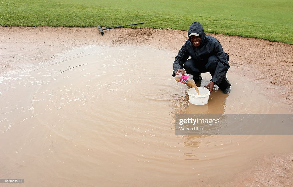 A waterlogged bunker is drained ahead of The Nelson Mandela Championship presented by ISPS Handa at Royal Durban Golf Club on December 5, 2012 in Durban, South Africa.
