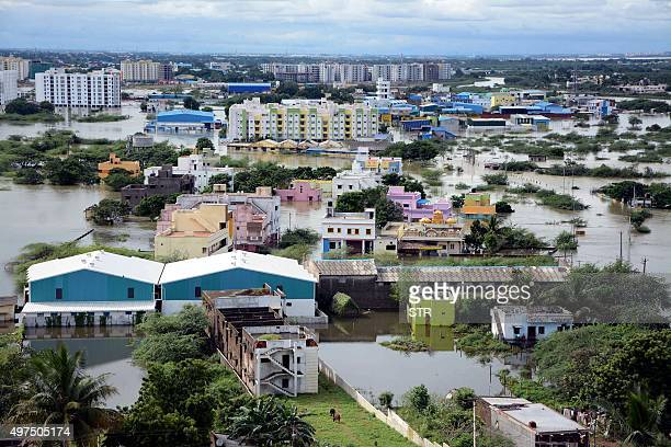 Waterlogged houses are pictured in a flooded suburb of Chennai on November 17 2015 India has deployed the army and air force to rescue floodhit...
