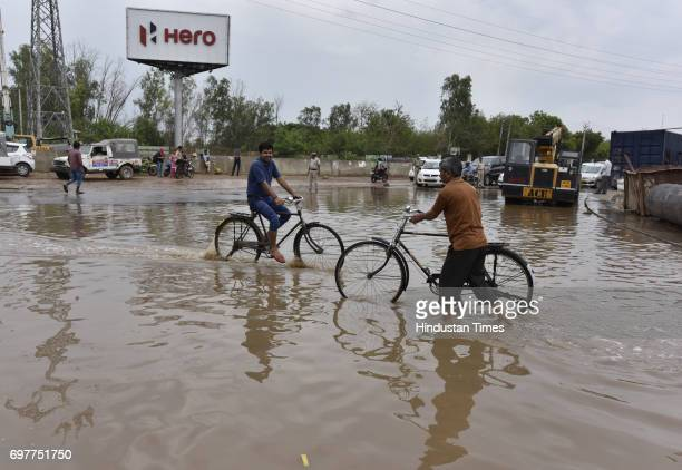 Waterlogging at Hero Honda Chowk after the heavy rainfall lashed Delhi and NCR on June 19 2017 in Gurgaon India With just one night of rain several...