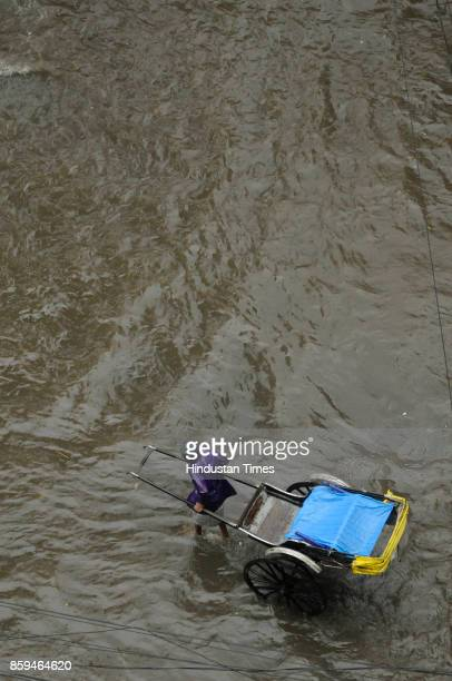 Waterlogging due to low depression rain fall from early morning on October 9 2017 at South Kolkata India Incessant rain and squally wind affected...