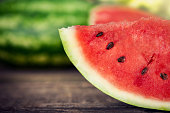 Watermelon close up.Sliced watermelon on wooden table.