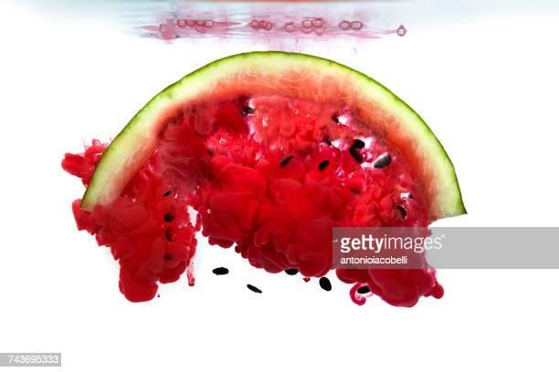 Watermelon dissolving in water