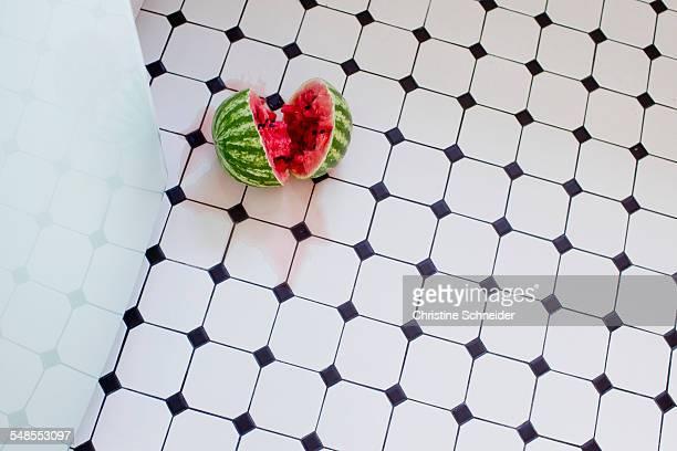 Watermelon in half on floor