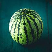 Watermelon On the dark wood in door low light