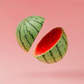 Watermelon sliced on pastel pink background. Minimal fruit concept.