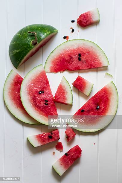 Watermelon slices on a white board