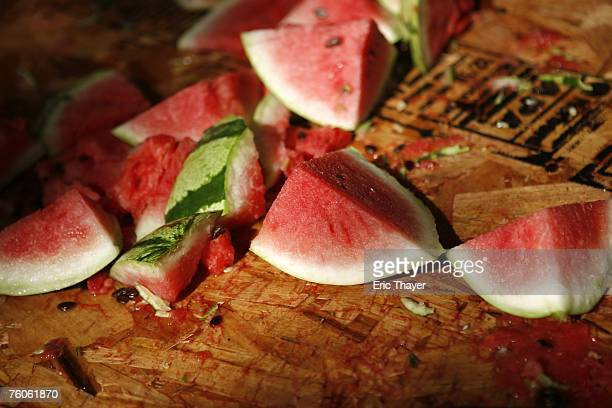 Watermelon slices sit on a table at the Duncan Hunter area of the Republican Straw Poll August 11 2007 in Ames Iowa An estimated 40000 people are...
