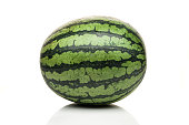 fresh whole watermelon standing isolated on white background