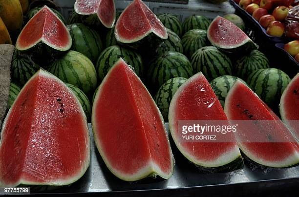 Watermelons at a stall at the Municipal market in Cartago some 25 km south of San Jose on March 13 2010 AFP PHOTO/ Yuri CORTEZ