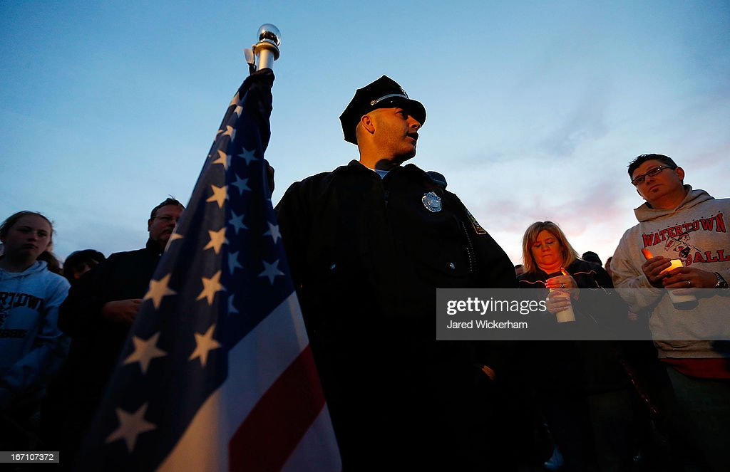Watertown Police officer Brandon O'Neill speaks to the crowd during a candlelight vigil at Victory Park on April 20, 2013 in Watertown, Massachusetts. A manhunt for Dzhokhar A. Tsarnaev, 19, a suspect in the Boston Marathon bombing ended after he was apprehended on a boat parked on a residential property in Watertown, Massachusetts. His brother Tamerlan Tsarnaev, 26, the other suspect, was shot and killed after a car chase and shootout with police. The bombing, on April 15 at the finish line of the marathon, killed three people and wounded at least 170.