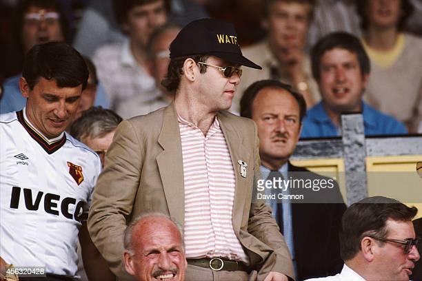 Watford chairman Elton John and manager Graham Taylor take their seats prior to a match at Vicarage Road circa 1984 in Watford England