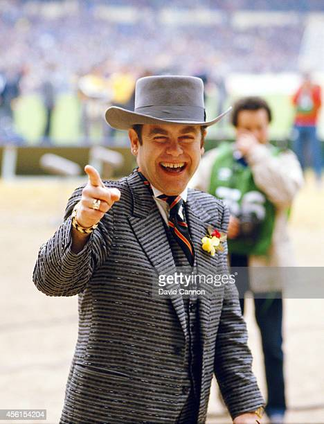 Watford chairman Elton John waves to fans before the 1984 FA Cup Final between Everton and Watford at Wembley Stadium on May 19 1984 in London England