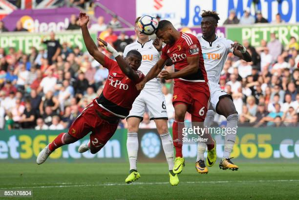 Watford defender Adrian Mariappa heads clear despite the attentions of Christian Kabasele and Tammy Abraham of Swansea during the Premier League...