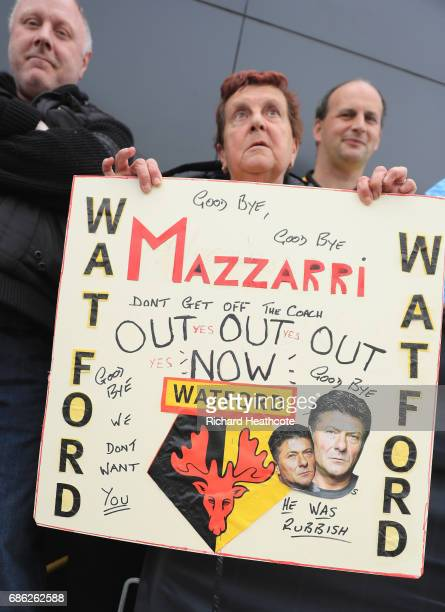 Watford fan displays a sign for Walter Mazzarri Manager of Watford prior to the Premier League match between Watford and Manchester City at Vicarage...