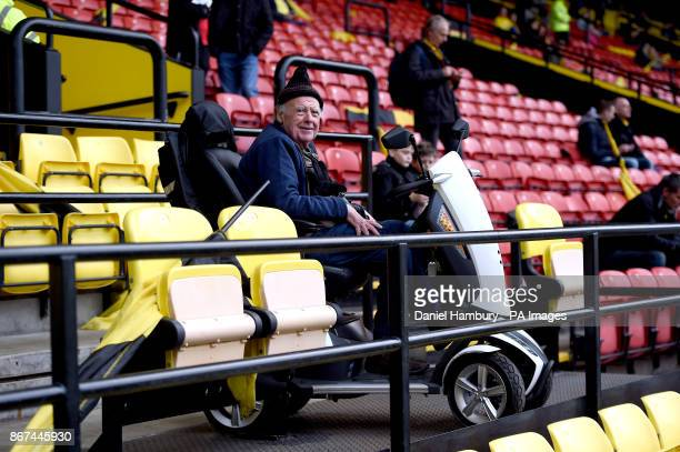 A Watford fan sits in a mobility scooter in the stands during the Premier League match at Vicarage Road Watford
