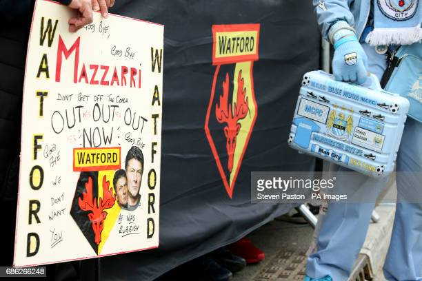 A Watford fan with a 'Mazzarri Out' sign during the Premier League match at Vicarage Road Watford